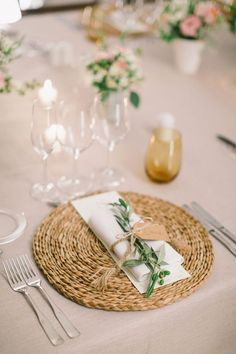 Sweet rustic garden table styling; rattan placemats, neutral linens and olive branch springs. \ Spring Wedding reception table styling
