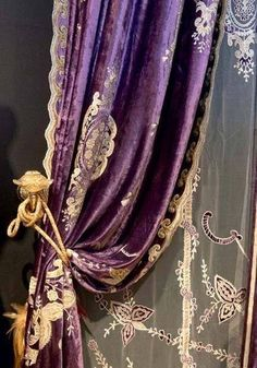 Antique purple velvet and lace curtains.