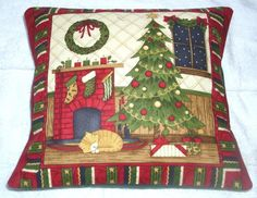 Ginger kitten under Christmas tree by the fireplace cushion £18.95
