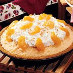 """Sunshine Ice Cream Pie Recipe -Bonnie Polson of Moravia, Iowa shares this pretty, easy-to-make frozen dessert. """"Many people tell me it tastes like the Dreamsicles they loved as children."""""""