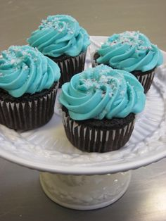 Blue frosting on chocolate cupcakes