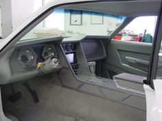 Pegasus street rod style upholstery interiors.custom dash door panels and console to the honeycomb stamped leather seats. Goolsby's Customs, 71 Mustang grey white modern