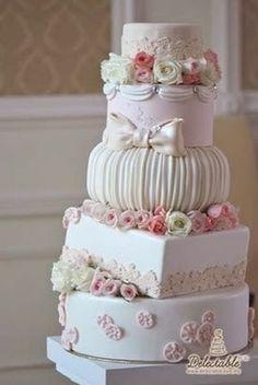 Topsy turvy flowered wedding cake