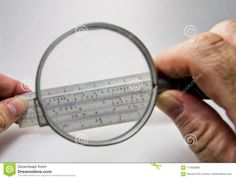 Photo about Old slide rule slipstick used as analogue computer for mathematical calcululs seen through a magnificant lens. Image of calculated, logarithmic, functions - 111833836