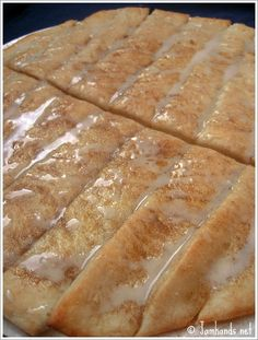 Cinnasticks  - sooooo good! Used Pillsbury seamless dough sheet spread on greased cookie sheet and baked only 10 min. Instead of butter in the glaze I used the TB melted ,to brush the crust rather than oil. Used only 1/4 cup sugar/cinnamon mixture,and 1/3 the amount of glaze. Cut into 12 strips > 125 calories a stick. DELICIOUS warm!!