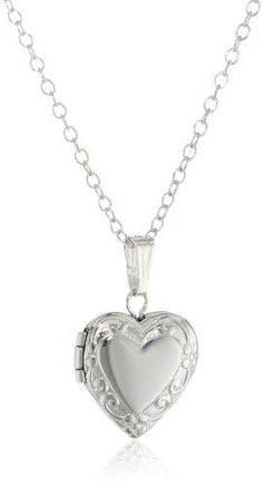 Make her feel special with the gift of her first heart-shaped locket. Crafted in sterling silver, it is embossed with an elegant floral framing for a lovely finish. Necklace featuring sterling silver locket with embossed pattern on border Inside photo window Spring ring clasp Not intended for children under three Domestic