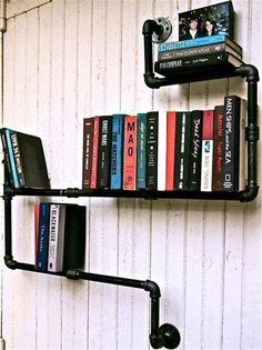Great use of raw building materials to create a functional awesome looking book shelf: industrial pipe bookshelf. Love this idea! Industrial Pipe, Industrial House, Modern Industrial, Industrial Bookshelf, Industrial Industry, Industrial Design, Industrial Apartment, Industrial Lighting, Industrial Basement