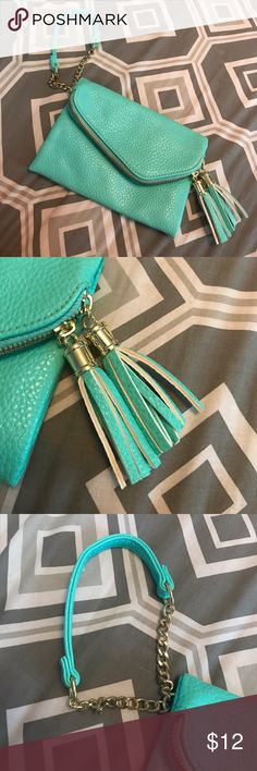 NWOT- never used teal wristlet NWOT! great condition super cute wristlet  for a night out! Maurices Bags Clutches & Wristlets