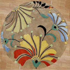 Overstock. http://www.overstock.com/Home-Garden/Hand-tufted-Contempo-Flowers-Beige-Wool-Rug-6-Round/4725541/product.html