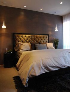 dark brown/brass walls makes the room look gorgeous