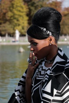 Janelle Monae at Paris Fashion Week Summer 16 View more pix on Un-ruly: http://un-ruly.com/janelle-monae-and-her-beehive-at-valentino/  #naturalhair, #updo, #janellemonae, #beehive