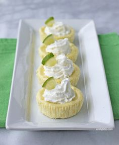 These Key Lime Cheesecake Cups are bright, citrusy and rich - perfect for Spring and portion control! Lightened up at just 106 calories each! www.emilybites.com