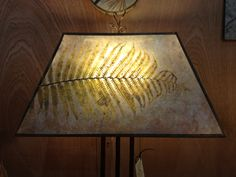 Large fern on heavy natural mica rectangle with Bronzy trim.  High Beams Ltd.