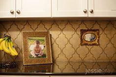 Painted arabesque pattern on kitchen backsplash.