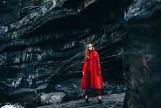 Martina Vobornikova looks sublime in scarlet-red against a dramatic rocky beach setting for Fashion Gone Rogue.