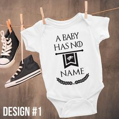 """Show off your obsession with Game of Thrones with this funny baby onesie. This bodysuit features the phrase """"A Baby Has No Name,"""" a play on the quote by Arya Stark, in the iconic Game of Thrones font. This onesie would make the perfect baby shower gift for parents to be who cannot get enough of Game of Thrones!  Get your onesie on GiftIdeasFinder.etsy.com!"""