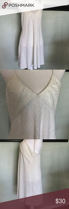 NWT Zara glitter dress Fun and flirty Zara dress. White body with silver glitter. Fitted body with spaghetti straps. Lower back line. Super pretty and fun! Arm pit to arm pit 18, center of chest to hem 25. Stretchy for a great fit. Zara Dresses
