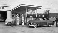 1953 Chevrolet 210 convertible still looked pretty new when this photo was taken, but we can't say the same for that bathtub Nash.  Sinclair Super Service in Fort Worth, Texas | The Old Motor