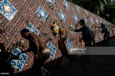 People place roses at Ban Nam Khem Tsunami memorial Wall remembering the 2004 Tsunami victims on December 27, 2014 in Phang Nga, Thailand. Thailand is remembering the 10th anniversary of the 2004 Indian Ocean earthquake and tsunami that killed more than 220,000 people across 14 countries, making it one of the deadliest natural disaster in recorded history.