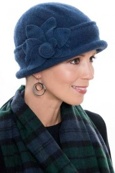 9a27ae289a7 With a classic cloche style and a decorative flower