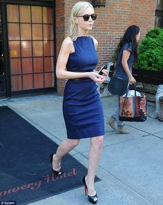 Carey Mulligan smoking hot in a fitted blue dress Louboutin heels in Manhattan. Sheesh, she's as glum as Kristen Stewart.