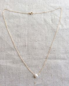 This is a single pearl necklace made of genuine high quality fresh water pearl and gold filled chain. This fresh water pearl necklace is light
