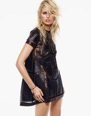 Karolina Kurkova models a black lace and leather dress from Valentino