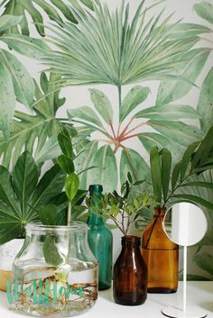 DESCRIPTION Transform any room in your home into a Hawaiian paradise with this adhesive wallpaper! This vinyl wallpaper features a bright and tropical print of exotic green leaves wall decals, all ove
