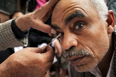 A man has kohl applied to his eyelids at the Grand Mosque in Sana'a, Yemen, on June 19, 2015, <span> during the month of Ramadan</span>.