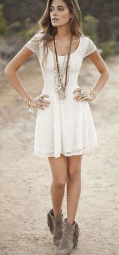 "the ONLY time ""cowboy"" boots and a dress look good"