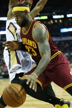 LeBron James #23 of the Cleveland Cavaliers drives the ball around Dante Cunningham #44 of the New Orleans Pelicans at Smoothie King Center on December 12, 2014 in New Orleans, Louisiana.