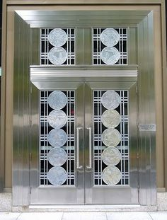 These super stainless steel doors were designed by artist Charles Comfort for the Toronto Stock Exchange (TSE) building on Bay St which was built in 1937.