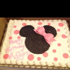 Minnie Mouse cake DIY- We bought a polka-dot cake from Sams Club and asked them to put the bow on the side. I then removed the center polka dots and lightly traced a Mickey cut out with a toothpick. With black frosting I pipped in dots, starting in the center and going circular, using a star tip. I then just placed the pink gumdrop bow.