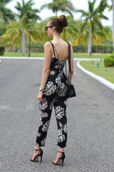 Step up your fashion game. Subscribe to receive one shoppable look a day at http://lookastic.com/newsletter. Shop this look for $100:  http://lookastic.com/women/looks/sunglasses-and-crossbody-bag-and-jumpsuit-and-watch-and-sandals/2835  — Black Sunglasses  — Black Leather Crossbody Bag  — Black and White Print Jumpsuit  — Silver Watch  — Black Suede Sandals