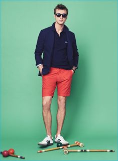"""Everyday Style: Clément Chabernaud wears J.Crew Ludlow summerweight cotton-linen blazer in coastline navy, Lacoste for J.Crew polo shirt, 9"""" Stanton shorts, Adidas Samba sneakers, Caputo & Co. leather snap bracelet and Irving sunglasses."""