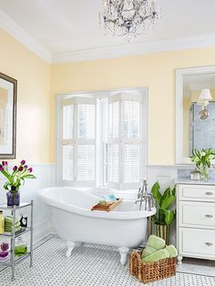 This spacious and sunny retreat was created by removing a walk-in closet and moving the toilet. Now there is space for a claw-foot slipper tub, an large single vanity, and a roomy walk-in shower.