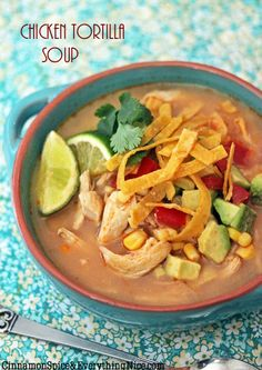 """Chicken Tortilla Soup - """"A south-of-the-border inspired soup with shredded chicken and corn swimming in a mildly spicy broth with chipotle peppers and fresh lime...A garnish of tortilla strips and avocado give it a crunchy, buttery bite"""" - Cinnamon Spice & Everything Nice"""