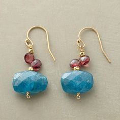 """REIGNING BLUE EARRINGS -- Two garnets hail the power of blue as a faceted drop of apatite holds court below. 22kt gold vermeil beads and 14kt goldfilled wires. USA. 1-3/8""""L."""