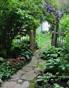 The Garden In Between Maybe some day I can do similar at the end of my house leading into the back. Who knows???