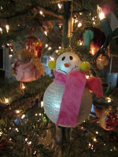 2005 Snowman. Handpainted wooden head on glass ball with embellishments
