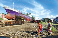 It's beginning to look a little like #Christmas in typhoon-ravaged Tacloban City. #Philippine President Aquino finally signed a master plan for the storm-hit communities as a ship remains stuck after it ran aground a year after the #storm on November 8 killed or left missing more than 7,350 people in the world's deadliest natural disaster. Super #Typhoon Haiyan #YolandaPH
