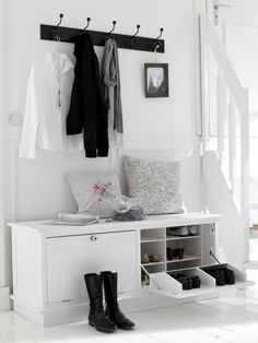 Bench to sit and put your shoes on with a coat rack. This would be a good use of space in the hall way.