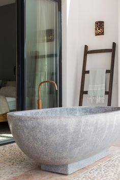 COCOON villa project on Ibiza bycocoon.com | with raw copper taps from our Piet Boon collection | barroom design | stone freestanding bathtub | interior design | villa design | luxury design products for easy living | Dutch Designer Brand COCOON