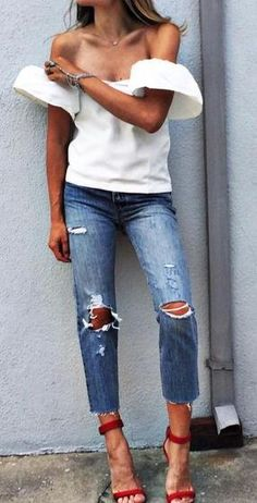 off shoulders top. ripped jeans. red sandals.
