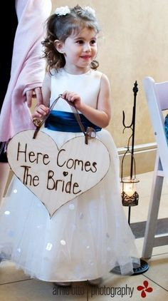 """Adorable heart-shaped """"here comes the bride"""" sign for a child to go down the aisle with before the bride. <3"""