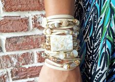 Ivory Genuine Leather Bracelet. One multi strand bracelet with crystals and stones. Adjustable closure.