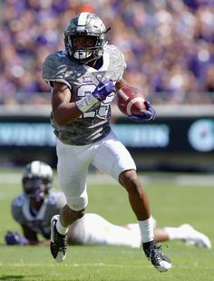 KaVontae Turpin #25 of the TCU Horned Frogs carries the ball against Demundre Freeman #26 of the Stephen F. Austin Lumberjacks in the second quarter at Amon G. Carter Stadium on September 12, 2015 in Fort Worth, Texas. (Sept. 11, 2015 - Source: Tom Pennington/Getty Images North America)