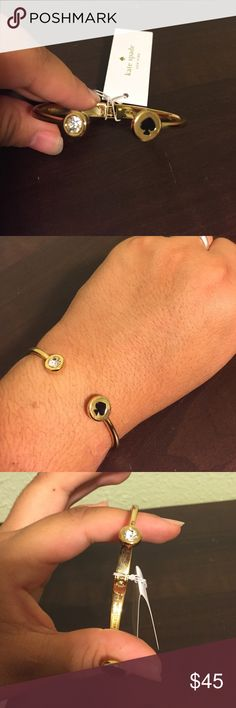 NWT Kate spade bangle NWT Kate spade bangle with a spade on one side and a clear gem on the other. It is a hinged bracelet so it can adjust to different wrist sizes. No trades and please use offer button. Kate Spade Jewelry Bracelets