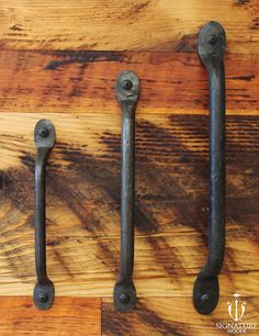 Hand Wrought Iron Door Pull. These handles are made by hand by Signature Woods' blacksmith and compliment our sliding barn doors with their on-of-a-kind look.