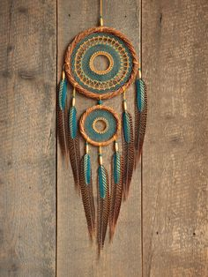 Handmade dream catcher. It is made in the gypsy styles. The design features are willow hoop, unique woven web, wooden beads, pheasant and goose hand painted feathers. It combines two colours: deep blue and golden. Only natural materials! This is my authors dreamcatcher. It is a excellent decoration for your home, and also an excellent gift for family members or friends.  Size: diameter of the willow hoop 7,5 inch(19cm) length of dreamcatcher 30 inch(77cm)  Color may vary slightly due to the…